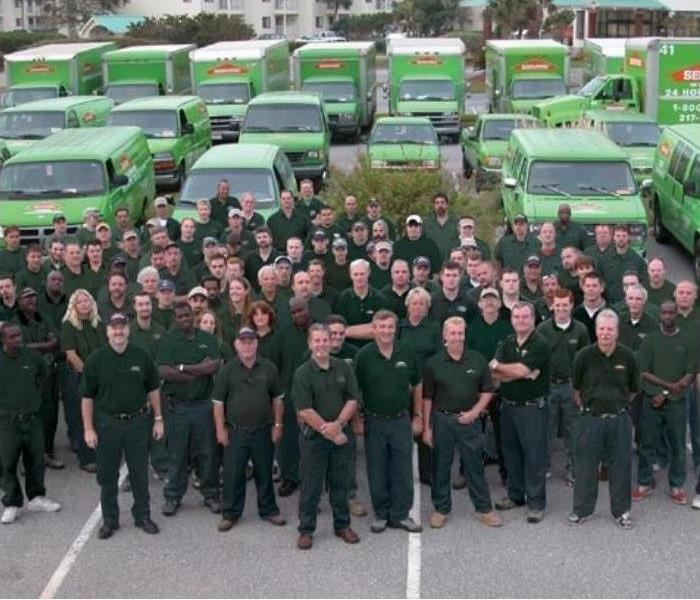 A big group of SERVPRO Employees and Vehicles