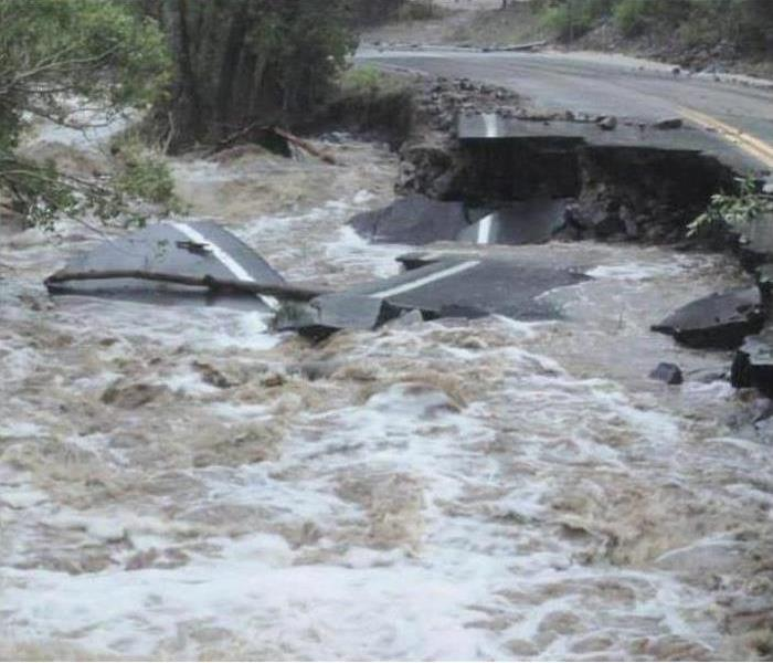 A road being washed out by a flash flood