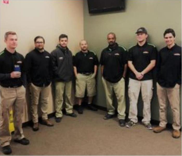 A group of male SERVPRO Technicians